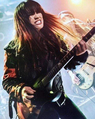 Kiki Wong wongo guitar travel book muay thai green eyes asian 3