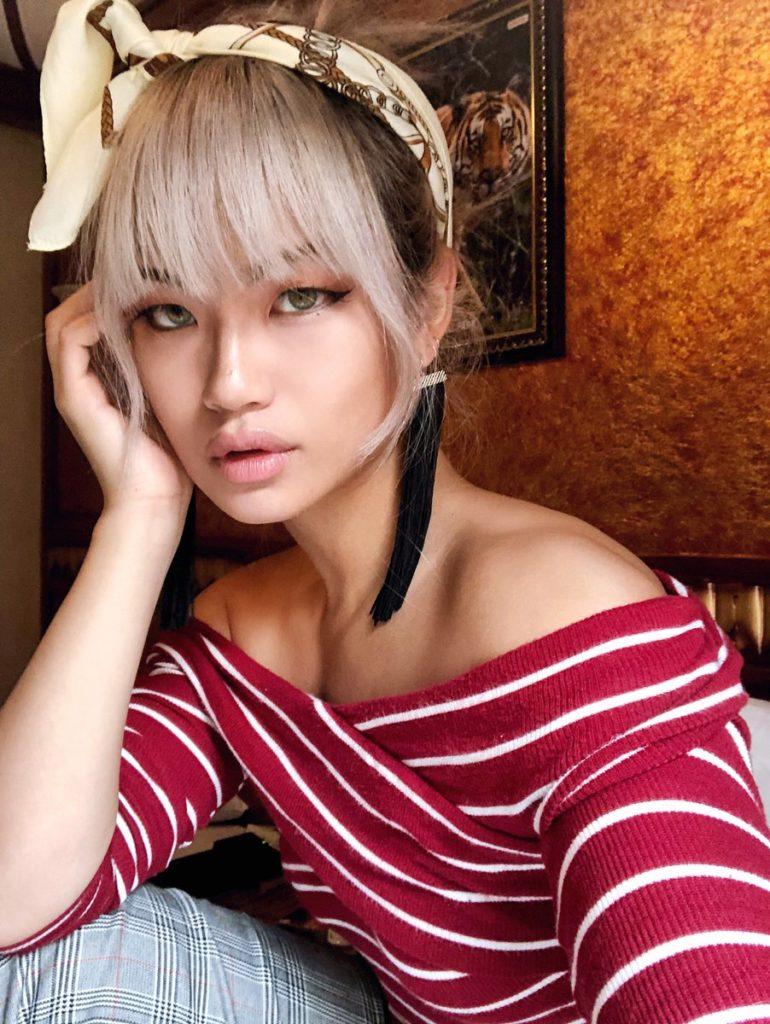 Kiki Wong wongo guitar travel book muay thai green eyes asian 1